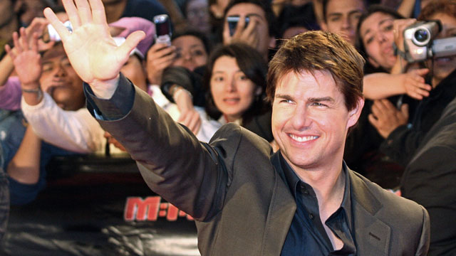 "PHOTO: US actor Tom Cruise waving to fans during the premiere in Mexico of his movie ""Mission Impossible III"" in Mexico City."