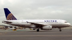 PHOTO: An Airbus A319 jet painted in United Continental Holdings Inc.'s new livery following the airlines' merger taxis down the runway at San Francisco International Airport in San Francisco, California, U.S., on Feb. 23, 2011.