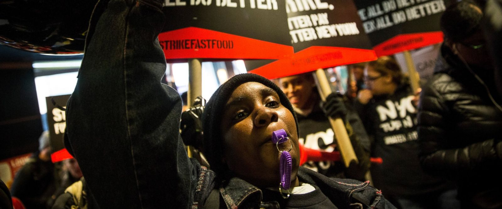 PHOTO: Protesters march through a McDonalds demanding a raise on the minimum wage to $15 per hour on Dec. 4, 2014 in New York City.
