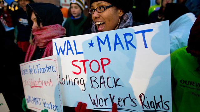 PHOTO: Workers and supporters march outside a local Wal-Mart retail stor