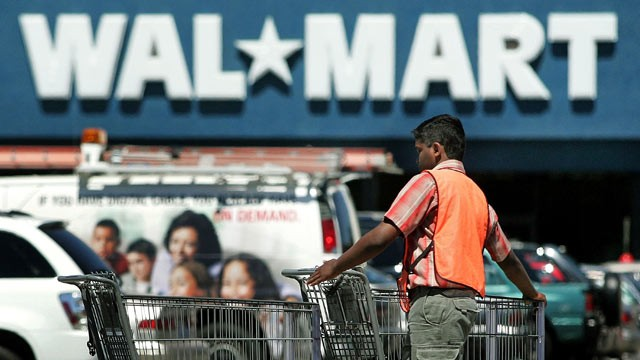 PHOTO: A worker collects shopping carts outside a Wal-Mart store in Mount Prospect, IL.