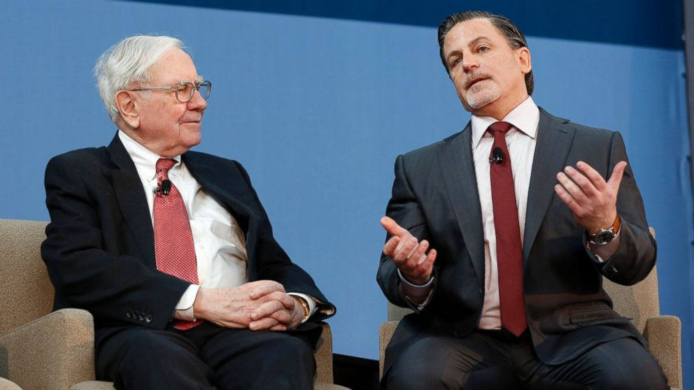 PHOTO: Warren Buffett, chief executive officer of Berkshire Hathaway Inc., left, listens to Dan Gilbert, founder and chairman of Quicken Loans Inc. in this Nov. 26, 2013 file photo taken in Detroit, Michigan.