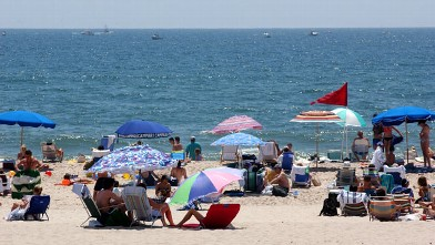 PHOTO: People enjoy a day at the beach in this July 22, 2001 file photo of Southampton, NY. The Hamptons, located at the east end of New York's Long Island, is a traditional summer escape for New Yorkers.
