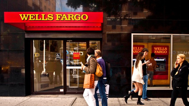 PHOTO: Pedestrians pass a Wells Fargo &amp; Co. bank branch in New York, Oct. 15, 2011.