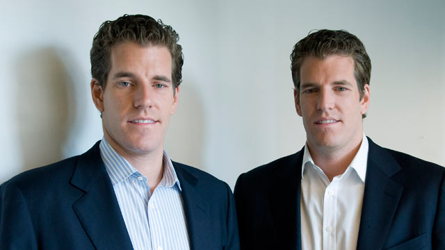 PHOTO: Cameron Winklevoss, left, and his brother, Tyler, stand for a portrait after a television interview in New York, Oct. 7, 2010.