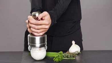 PHOTO: A young woman is shown using an onion chopper.