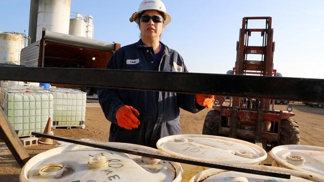 PHOTO: Linda Trujillo mixes chemicals used in the fracking process. She moved her family from New Mexico to Kansas after hearing about the money being made working in the oil fields.