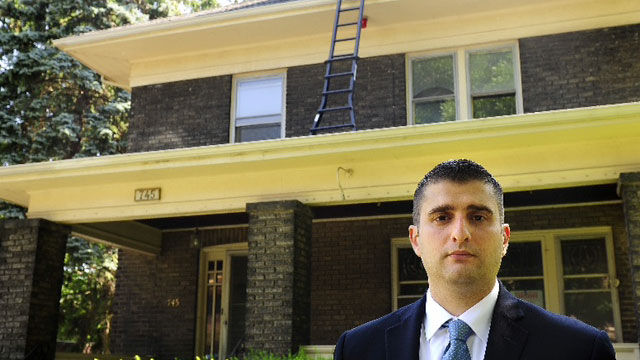 PHOTO: Niagara Falls Director of Community Development Seth Piccirillo stands in front of a house in on Fourth Street in Niagara Falls, June 10, 2012.