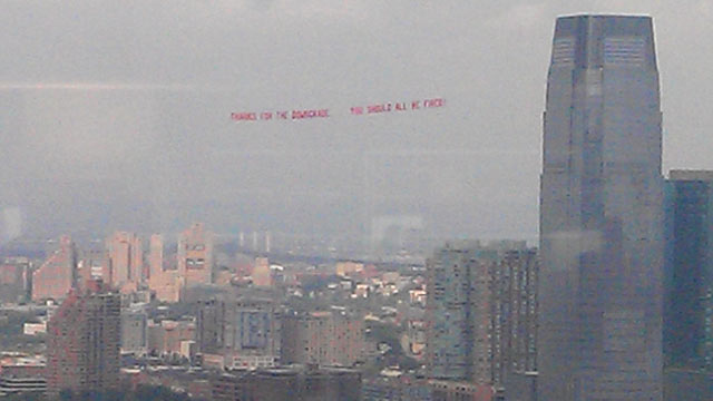 "PHOTO: A plane flew over S&P headquarters trailing a banner that read, ""Thanks for the downgrade, you should all be fired."""