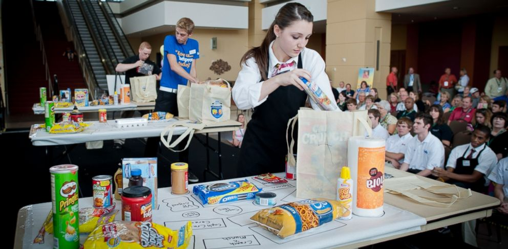 PHOTO: Contestants compete in this past National Grocers Association Best Bagger Championship.
