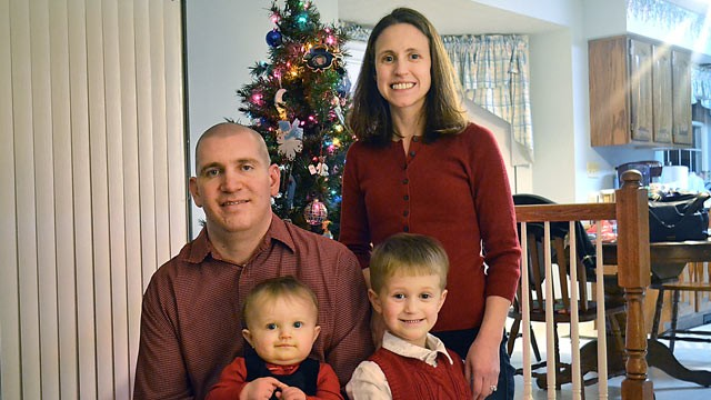 PHOTO: Daniel Herrmann, pictured with his family, is suing his former employer, Bank of America, saying they did not accommodate his disabled right leg, arm and hand.