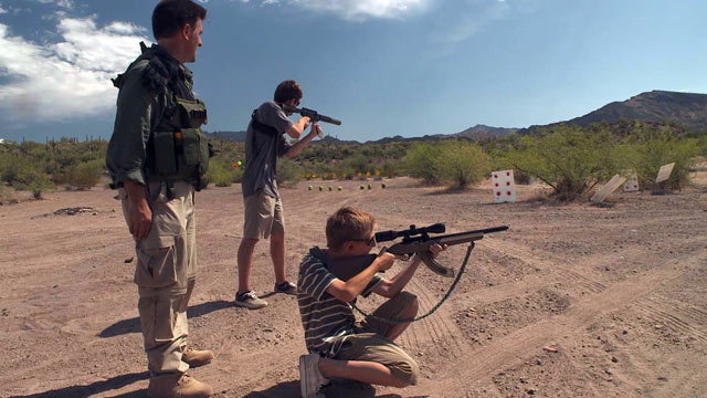 PHOTO: Tim Ralston trains his children in the use of firearms so they are prepared for doomsday.