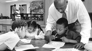 PHOTO Earl Phalen tutors first and second grade students in Dorchester, Mass.,