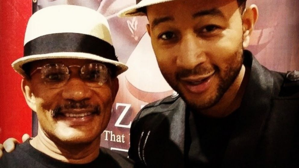 "PHOTO: John Legend posted this photo to Instagram on Aug. 8, 2014 with the caption, ""With my dad selling Popz Topz at the Neighborhood Awards in Atlanta!"""