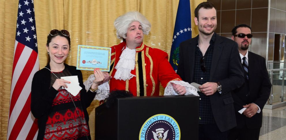 PHOTO: A Las Vegas official (in colonial garb) grants a Presidential Pardon on Presidents Day for any bad behavior the recipient may have committed while visiting Sin City.