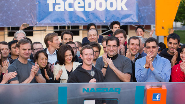PHOTO: Mark Zuckerberg, CEO and founder of Facebook, and COO Sheryl Sandberg gather with a throng of cheering employees at the company headquarters in Menlo Park, Calif. to ring the stock market's opening bell, May 18, 2012.