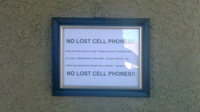 PHOTO: A pointer posted nearby Wayne Dobson's front doorway in North Las Vegas tells people he doesn't have mislaid dungeon phones.