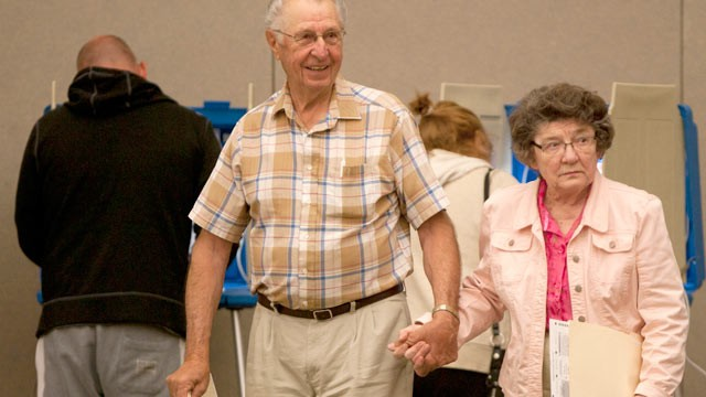PHOTO: Wallace and Evelyn Feltman walk to the ballot box after filling out their ballots at the Alerus Center, Grand Forks, North Dakota, June 12, 2012.