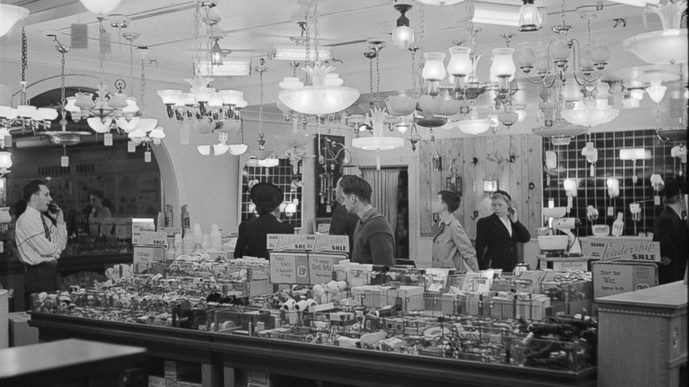 PHOTO: Customers shop for home goods in the Sears Roebuck store in Syracuse, New York in October, 1941.