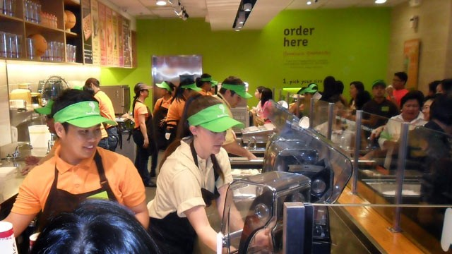 PHOTO: Employees work through the new opening of a Jamba Juice.