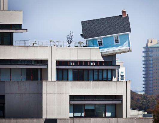 Cottage Hangs Off 7-Floor Building