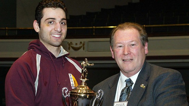 PHOTO: Tamerlan Tsarnaev, left, accepts the trophy for winning the 2010 New England Golden Gloves Championship in Lowell from Dr. Joseph Downes. (SUN/JULIA MALAKIE)