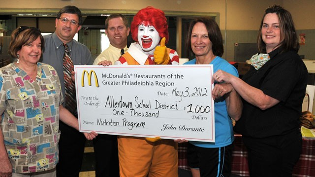 PHOTO: From left: Donna Schuler, Joe Bonita, David Hahn, Ronald McDonald, Vickie Kahler, and Sue Ennis, present a $1,000 donation from McDonald's to support nutrition and fitness education for ASD elementary students.
