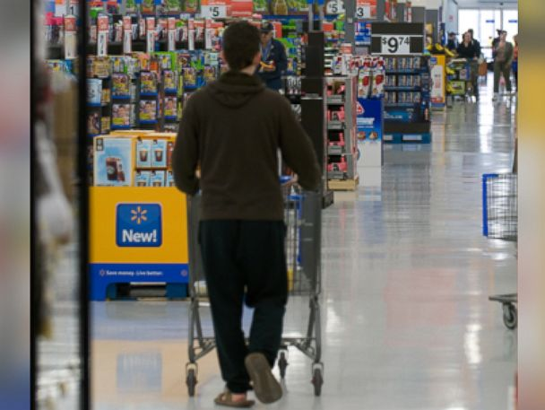 PHOTO: Customers shop in Action Alley at a Walmart Supercenter, July 6, 2012.