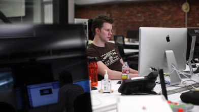 PHOTO:  An employee works on a computer at the headquarters of Web-building service Weebly in San Francisco, Feb. 28, 2013.