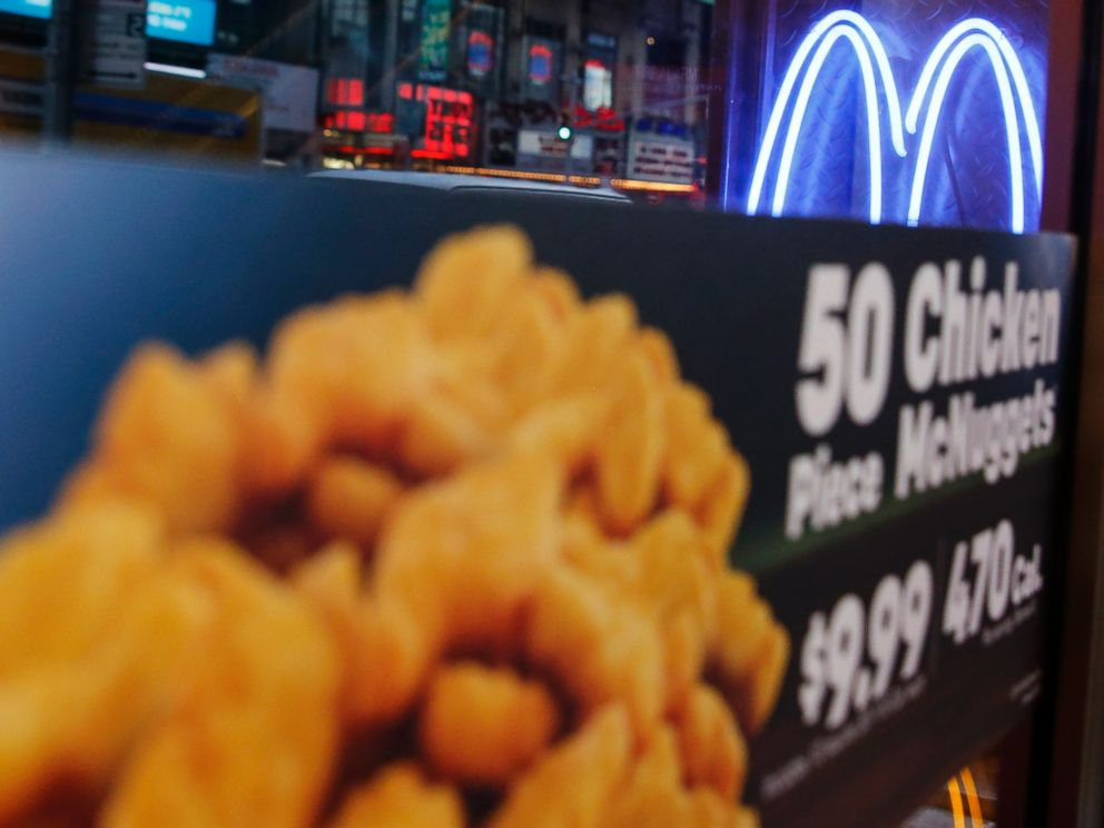 PHOTO: Neon McDonalds Golden Arches are seen at the Times Square location in New York City on Jan. 29, 2015.