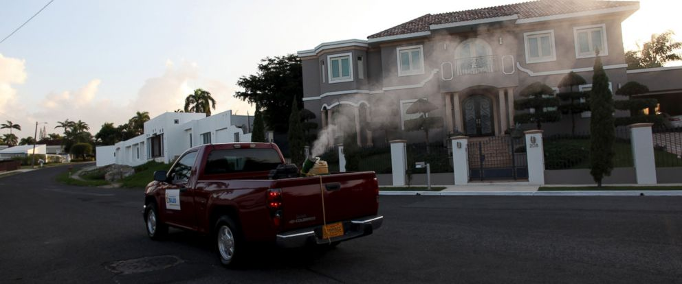 PHOTO: A pick-up truck from the Department of Health releases a pesticide to prevent the spread of Zika carrying mosquitos in San Juan, Puerto Rico, Jan. 27, 2016.