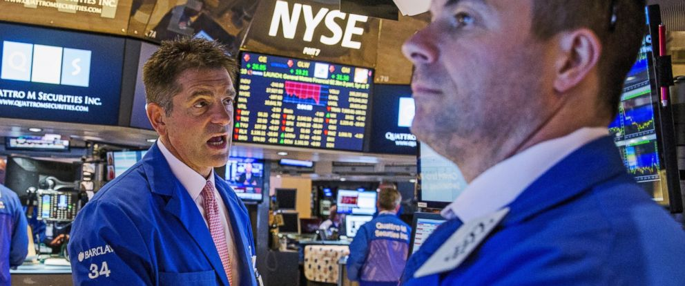 PHOTO: Traders attempt to figure out what is happening as trading resumes following a several hour long stoppage on the floor of the New York Stock Exchange in New York, July 8, 2015.