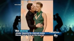 VIDEO: John Travolta gave Scarlett Johansson a kiss on the cheek while on the red carpet.