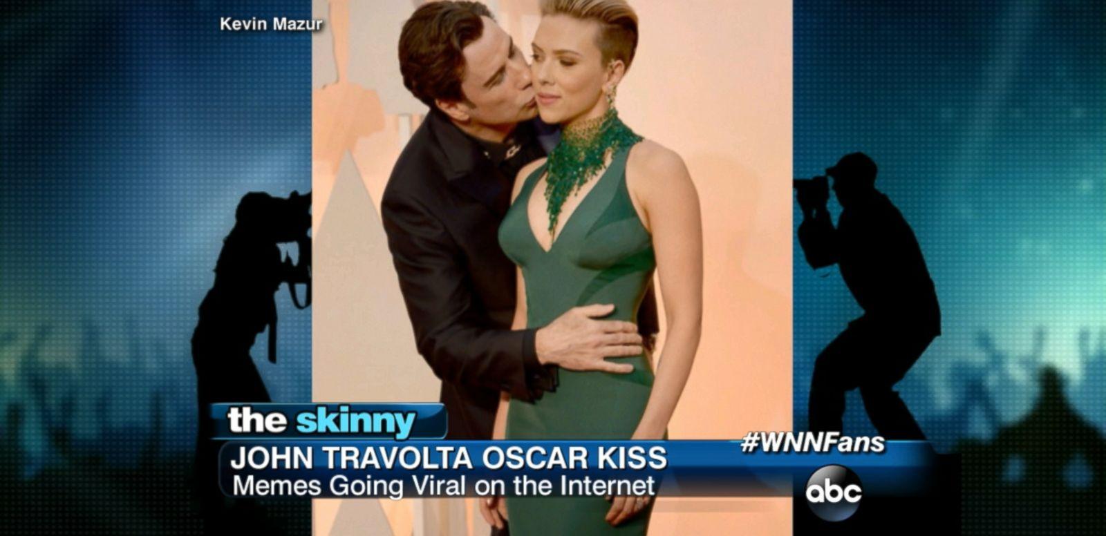 VIDEO: John Travolta gave Scarlett Johansson a kiss on the cheek while on the red carpet.