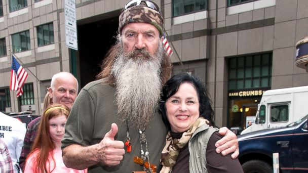 "PHOTO: Phil Robertson and Kay Robertson visit ""Extra"" in Times Square on May 7, 2013 in New York."
