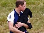 PHOTO: Catherine, Duchess of Cambridge and Prince William with their pet dog Lupo.