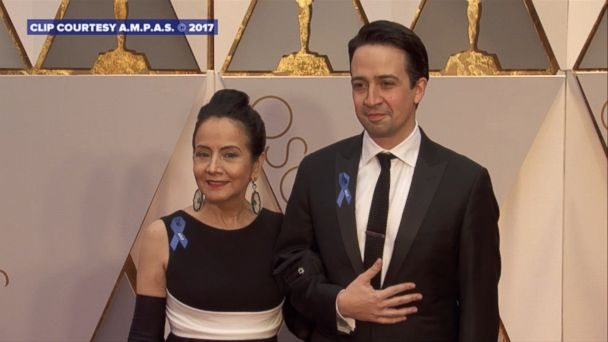 As part of a new initiative to support the American Civil Liberties Union, Oscar nominees and other stars are wearing blue ribbons with the organization's name on them.