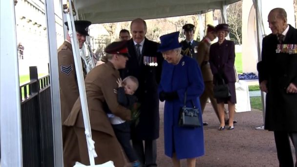 VIDEO: Alfie Lun, 2, was supposed to present the queen with flowers at the unveiling of a war memorial in London.