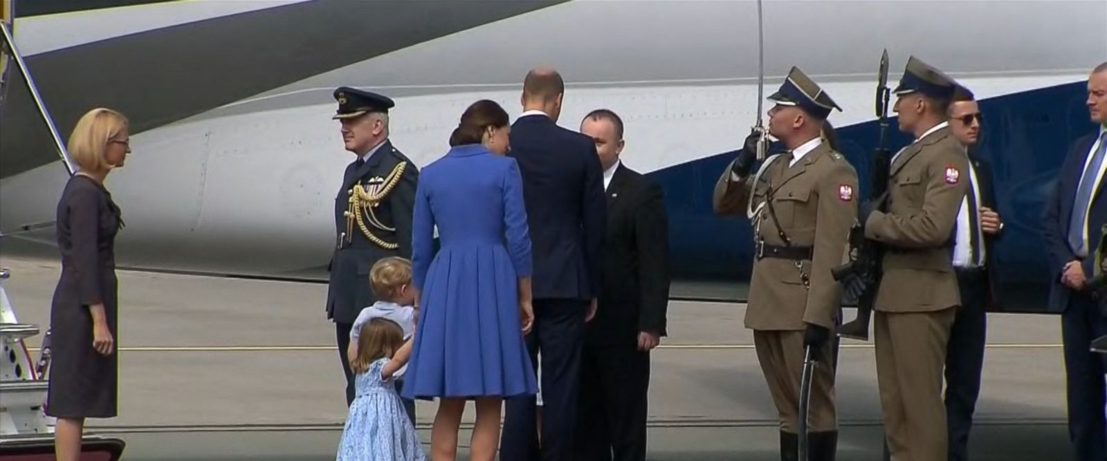 Charlotte, 2, was by the side of her mom, Princess Kate, when she ducked into a curtsy as the royal family departed Poland.
