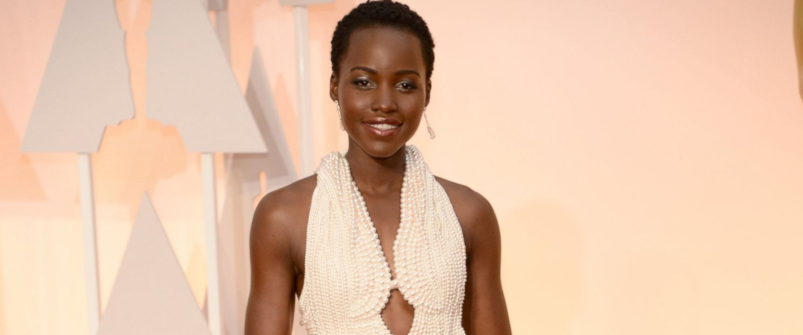 PHOTO: Actress Lupita Nyongo arrives in Chopard to the 87th Annual Academy Awards on Feb. 22, 2015 in Hollywood, California.