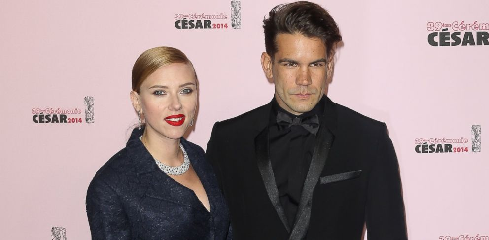 PHOTO: Scarlett Johansson and Romain Dauriac arrive for the 39th Cesar Film Awards 2014 at Theatre du Chatelet on Feb. 28, 2014.