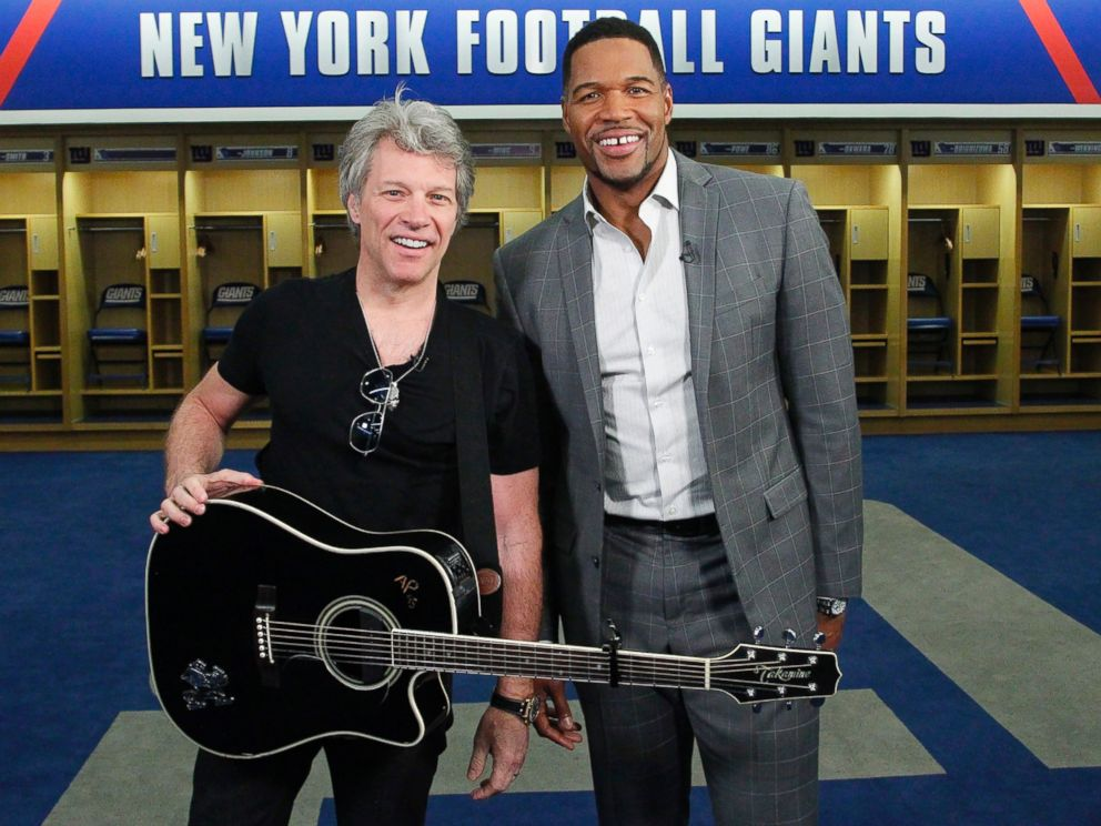 PHOTO: ABC News Michael Strahan, right, joined Jon Bon Jovi at MetLife Stadium in New Jersey as the rock singer surprised the graduating class at Fairleigh Dickinson University commencement with a performance.