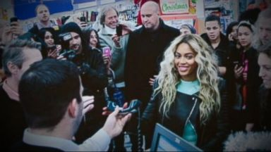 PHOTO: Beyonce dropped into a Walmart store in Tewksbury, Mass. to ambush shocked shoppers and spread some holiday cheer.