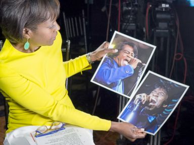 PHOTO: ABCs Deborah Roberts holds a photo of the real James Brown next to a photo of actor Chadwick Boseman playing the music legend in the new biopic, Get On Up.