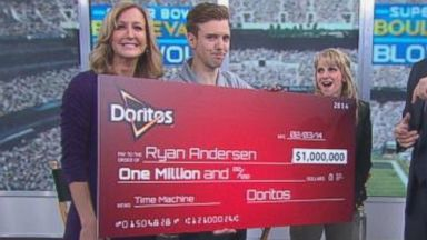 PHOTO: Ryan Thomas Anderson holds his $1M check.