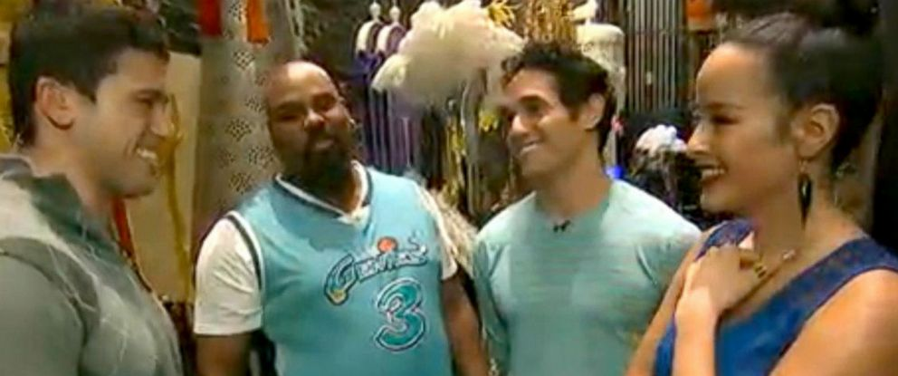PHOTO: Gio Benitez chats with the cast of Aladdin backstage.