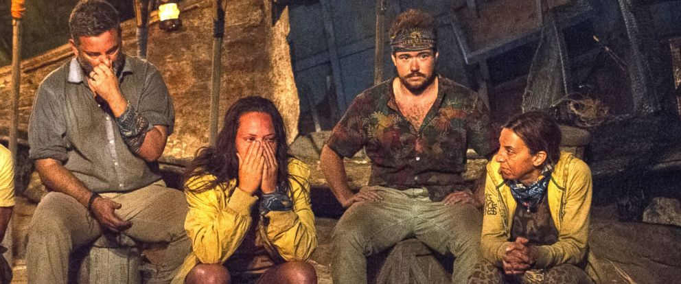 """PHOTO: In this image released by CBS, contestants, from left, Jeff Varner, Sarah Lacina, Zeke Smith and Debbie Wanner appear at the Tribal Council portion of the competition series """"Survivor: Game Changers."""""""