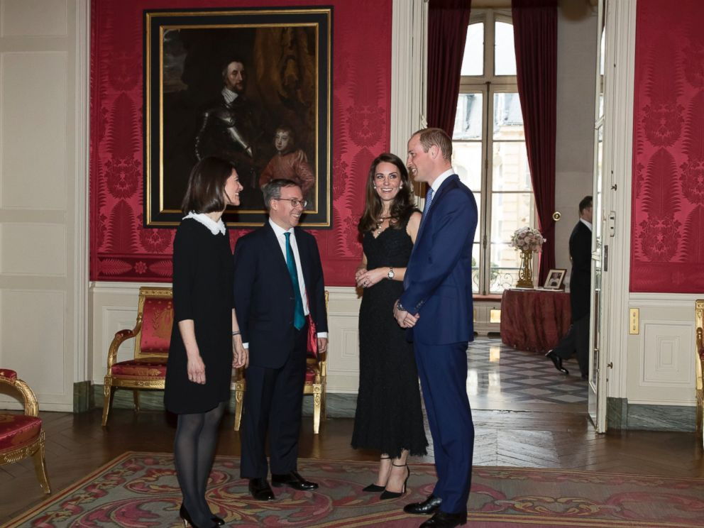 PHOTO: Britains ambassador to France, Lord Ed Llewellyn, second left, and his wife Anne, greet Prince William and Kate, Duchess of Cambridge as they arrive for a reception at the British embassy in Paris, March 17, 2017.