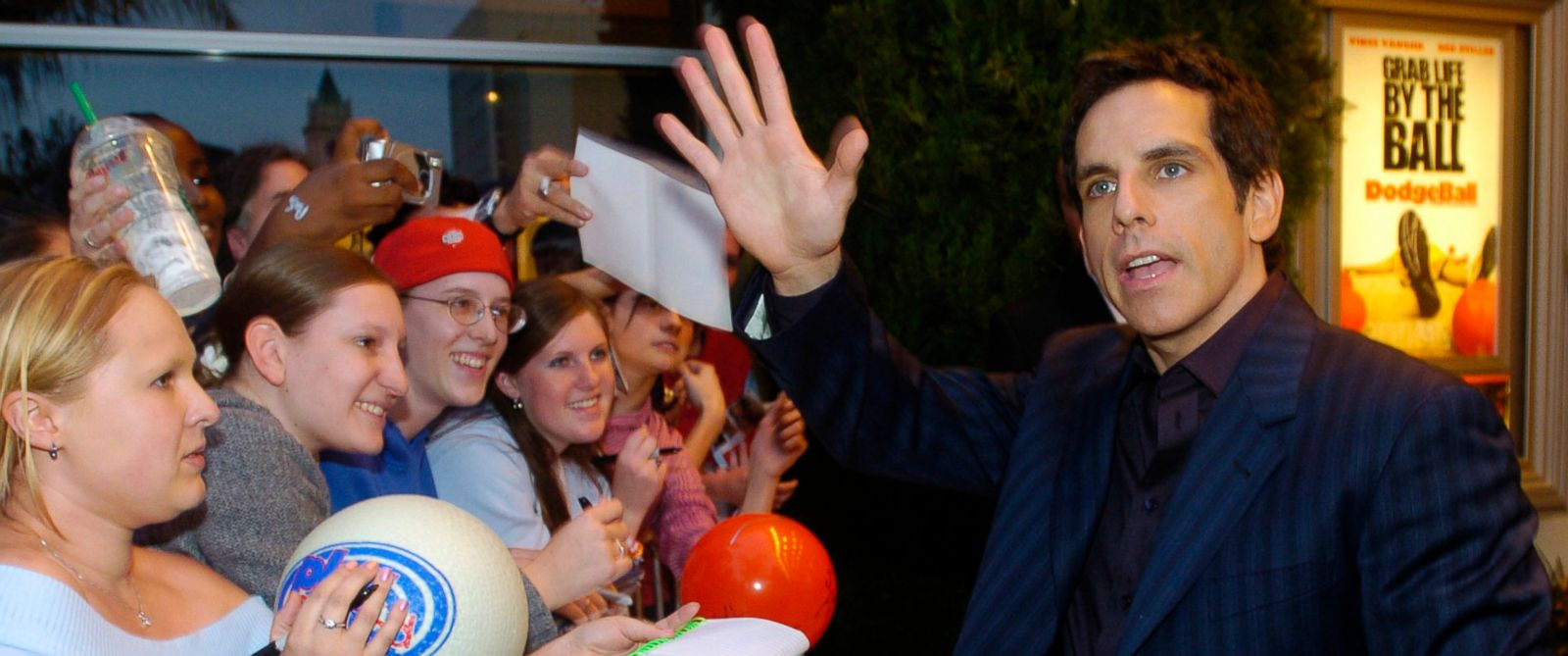 """PHOTO: Ben Stiller waves to fans outside the premiere of """"Dodgeball: A True Underdog Story,"""" in Los Angeles, June 14, 2004."""