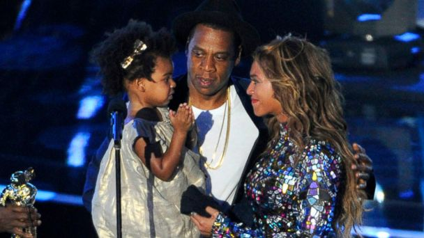 PHOTO: Beyonce on stage with Jay Z and their daughter Blue Ivy as she accepts the Video Vanguard Award at the MTV Video Music Awards in Inglewood, Calif.